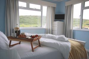 Breakfast in bed, Langarrow. Holywell Bay.